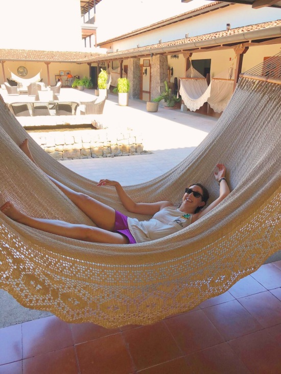 relaxing in the hammock in the lobby of JW Marriott Guanacaste