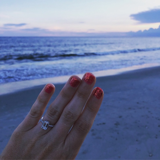 emerald cut engagement ring at sunset