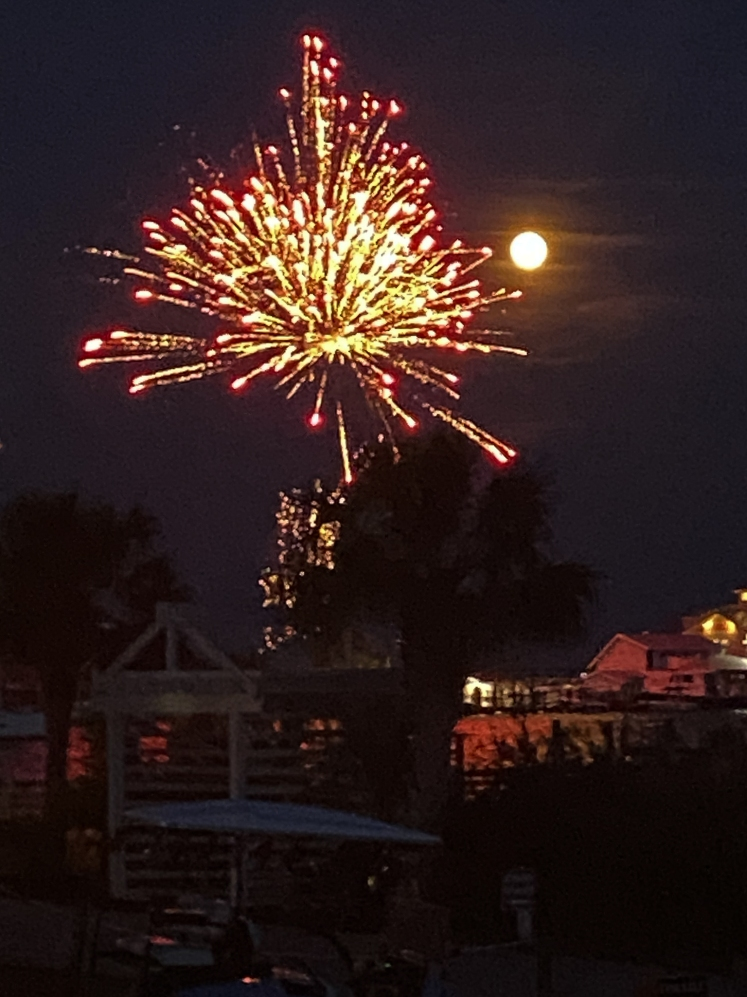 fourth of july fireworks with a full moon