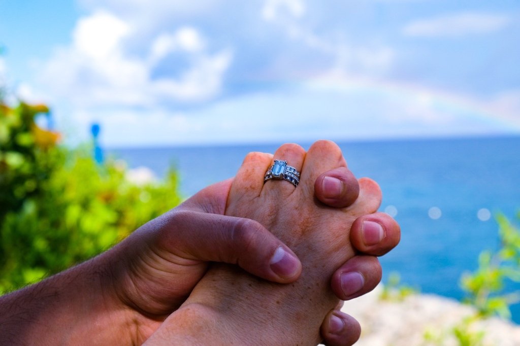 new wedding rings and a rainbow at the rockhouse hotel
