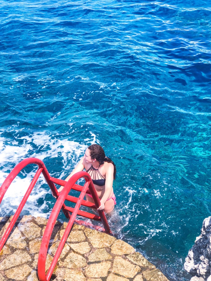 Jumping into the ocean at the Rockhouse Hotel